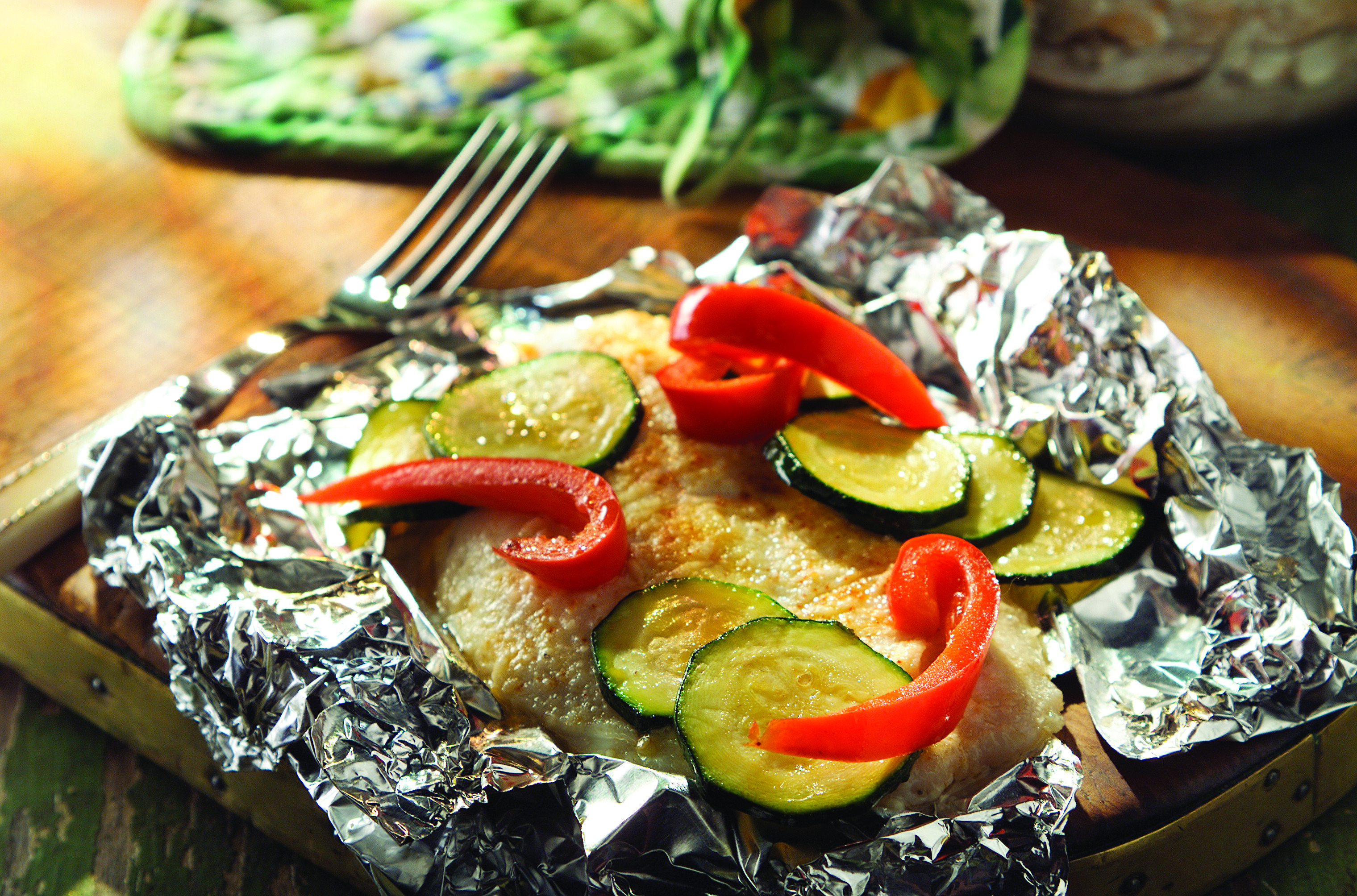 Foil-Wrapped Fish with Creamy Parmesan Sauce