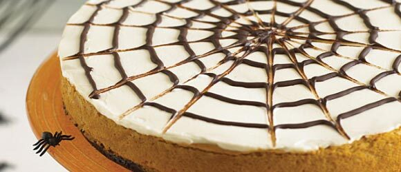 Spider Web Drizzle Pumpkin Cheesecake